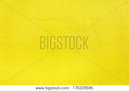 Yellow painted wooden wall useful as background