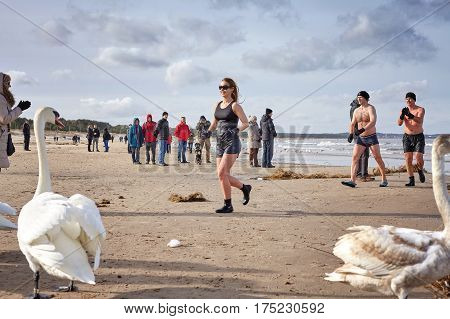 Swinoujscie, Poland - February 25, 2017: Fans Of Winter Swimming Run To Warm Up On The Beach. Winter