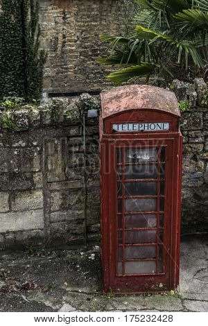 Red vintage public phone in the one of street in Bradford on Avon in England.