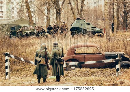 Gomel, Belarus - November 26, 2017: Soviet soldiers are beginning to storm the German positions. Reconstruction of the battle in Gomel