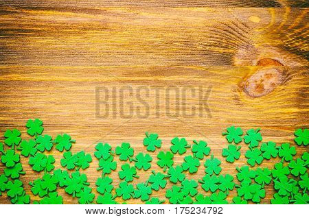 St Patrick's Day concept. St Patrick's Day background with green quatrefoils on the wooden background -St Patrick's Day concept. St Patrick's Day festive background - St Patrick's Day card