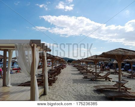 Beach beds on the private beach with umbrella romance time seeing the sea