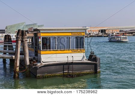 Venice,Italy-February 26 2011: Image of the Vaporetto station Trochetto on February 26 2011 in Venice. Vaporetto is a waterbus specific for Venice.