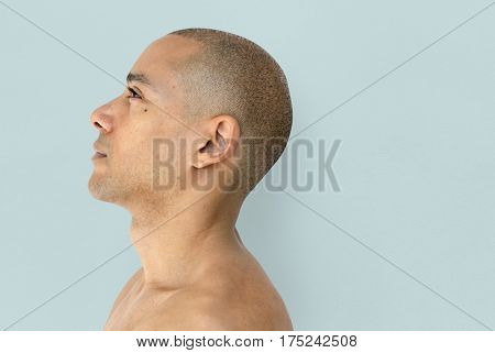 A skinhead guy is in a studio shoot