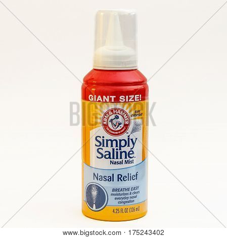New York March 2 2017: A Simply Saline nasal mist bottle on white background.