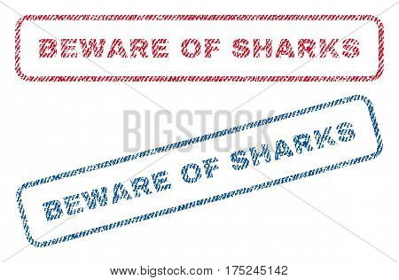 Beware Of Sharks text textile seal stamp watermarks. Blue, red fabric vectorized texture. Vector tag inside rounded rectangular banner. Rubber sign with fiber textile structure.