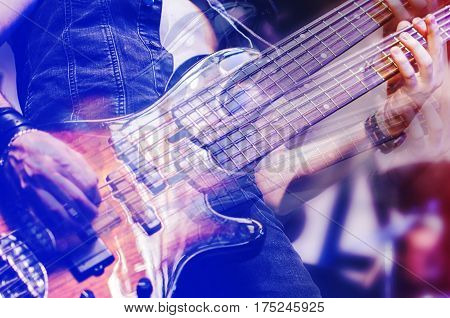 Guitar neck close-up on a concert of rock music in the hands of a musician. guitarist player