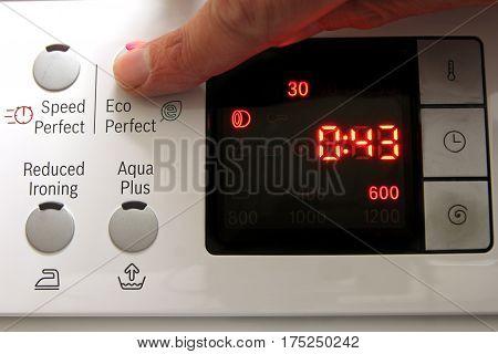 Setting The Economy Setting On A Domestic Washing Machine For Economical Laundry
