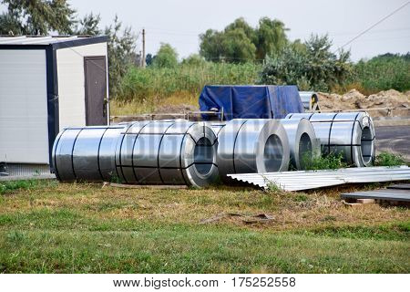 Rolls Of Sheet Metal. Storage Of Building Materials