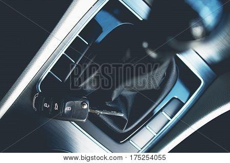 New Car Buying Concept. Stick Shift Car Cockpit and the Car Keys Closeup.