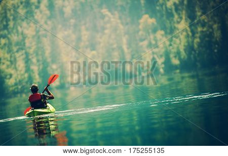 Scenic Kayak Lake Tour. Senior Kayaker on the Lake.