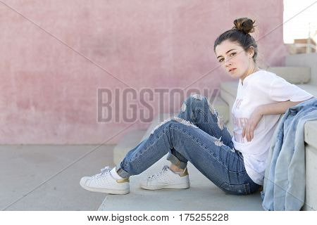 Portrait Of Teenage Girl Sitting