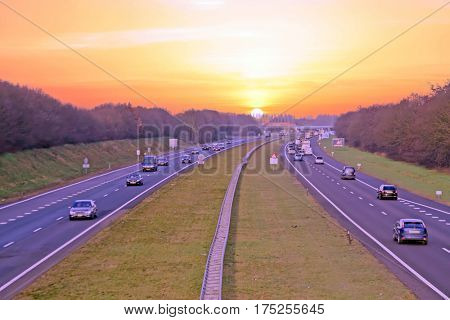 Traffic on highway A1 in the Netherlands at sunset