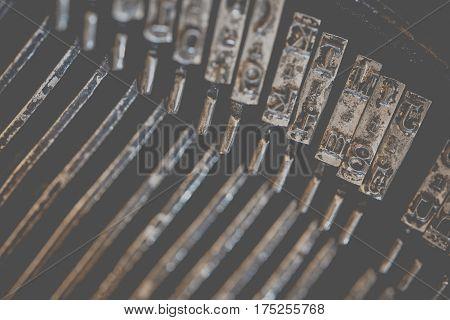 Typewriter Metal Types Photo Background. Typing Elements Macro Photo.
