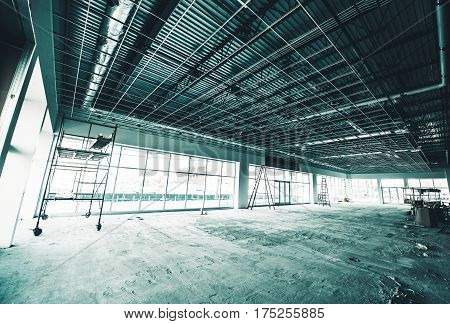 Warehouse Construction Site. Warehouse Interiors Under Construction. Commercial Remodeling.
