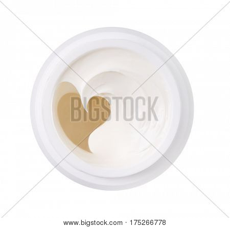 Jar with cosmetic cream, cream in the form of heart.Isolated on white background