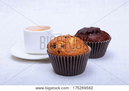 Fresh homemade muffins and white cup of Cappuccino on white background