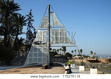 Stylized sailboat in Tiberias on the quay of the Sea of Galilee