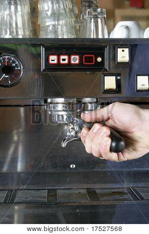 Loading the bayonet into the professional espresso machine.