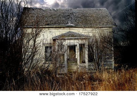 An old abandoned farm house on the prairie that looks haunted