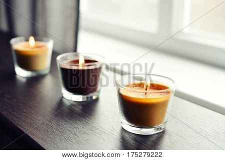 Cosy Candles On An Wooden Table