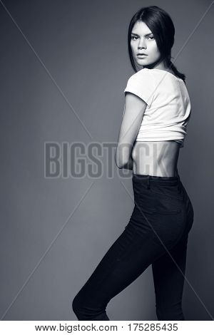 Shot of a woman sideways standing at studio