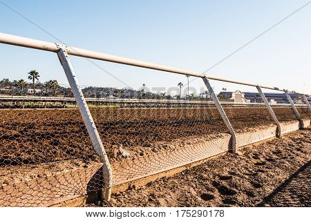 DEL MAR, CALIFORNIA - NOVEMBER 25, 2016:  Close-up view of the dirt racetrack at the Del Mar horse racing venue.