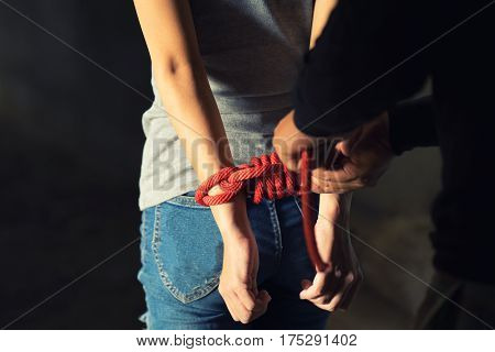 Tied Rope Hands Of Abused Woman
