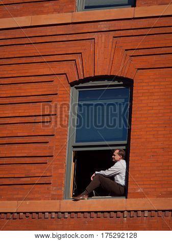 Businessman In Window