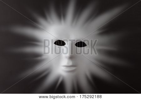 Human Face Emerging With Sun Rays From Black Background - Human Face On Sun Concept.