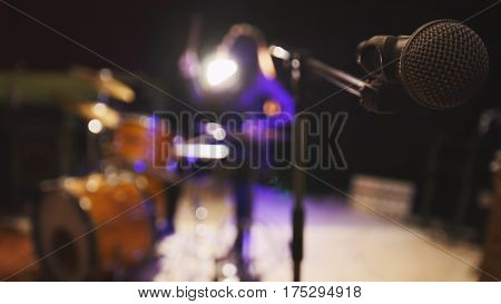 Teen rock music - passionate girl percussion drummer perform music break down, de-focused, wide angle
