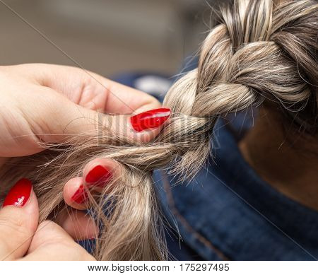 braided pigtails in the beauty salon . Photo of the person