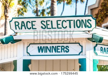 Race selections booth at a thoroughbred horse racing track.