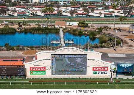 DEL MAR, CALIFORNIA - NOVEMBER 25, 2016:  Tote board and pond of the Del Mar racetrack, the second largest horse racing venue in the western United States.