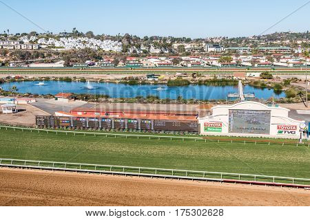 DEL MAR, CALIFORNIA - NOVEMBER 25, 2016:  The grass and dirt racetracks along with the tote board and pond of the Del Mar horse racing track.