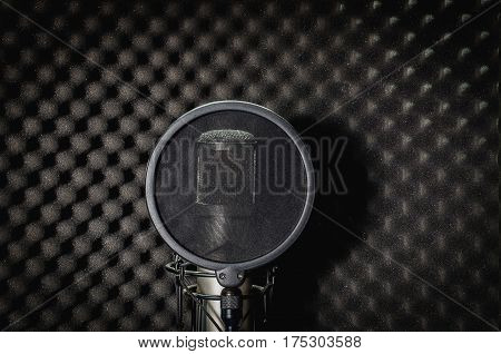 Mike recording studio on a black background.