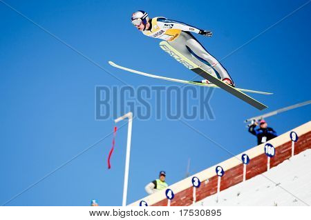 VIKERSUND, NORWAY - MARCH 15: First Place winner, Gregor Schlierenzaur of Austria competes in the FIS World Cup Ski Jumping Competition on March 15, 2009 in Norway.