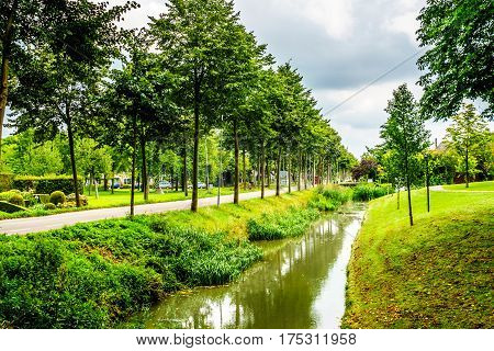 Typical scene of a canal running through the historic village of Midden Beemster in the Beemster Polder in the Netherlands