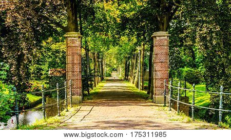 Brick Gate posts and tree lined lane into an Estate in the historic village of Midden Beemster in the Beemster Polder in the Netherlands