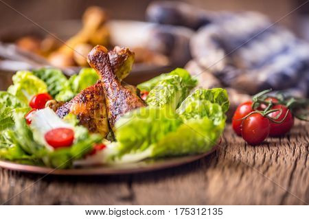 Grilled chicken legs lettuce and cherry tomatoes. Traditional cuisine. Mediterranean cuisine.
