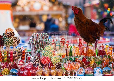 Photo of street shop selling various lollipops