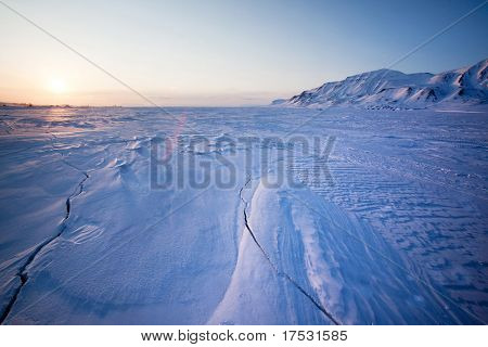 A landscape on the island of Spitsbergen, Svalbard, Norway late at night. View from Longyearbyen.