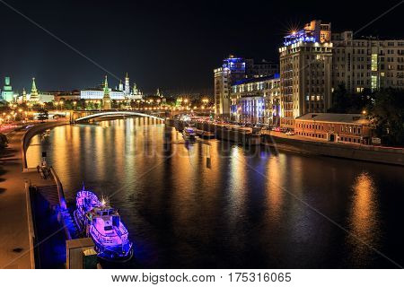MOSCOW/ RUSSIA - AUGUST 8, 2015. Night view of the Moskva-River with the Moscow Kremlin and the Variety Theatre (located in the famous House on the Embankment). Moscow, Russia.