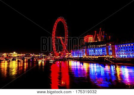 LONDON, ENGLAND - JANUARY 16, 2017 Big Eye Ferris Wheel Thames River Westminster Bridge Night Westminster London England.