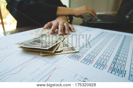 Woman Is Counting Money With Statement Paper And Use Computer Financial Concept.