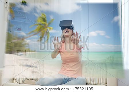 technology, augmented reality, cyberspace, entertainment and people concept - happy young woman wearing virtual headset or 3d glasses with exotic tropical beach projection at home