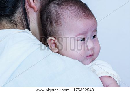 Mother and baby. Lovely asian girl resting on her mother's shoulder. Happy family spending time togetherness. A nice family concepts. Mother's Day celebration.