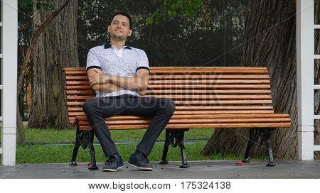 Happy Man Sitting Alone On Park Bench