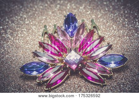 Haircomb in a shape of a flower decorated with purple rhinestones fashion jewellery. poster