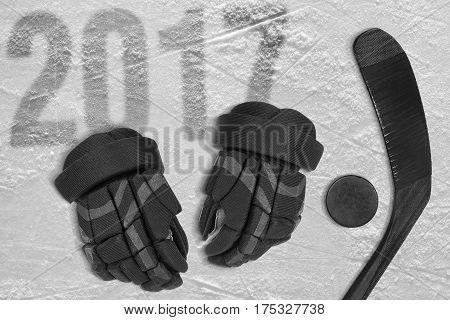 Hockey stick gloves and puck on ice. Concept hockey season